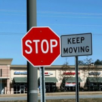 Stop sign clashing with Keep Moving signs